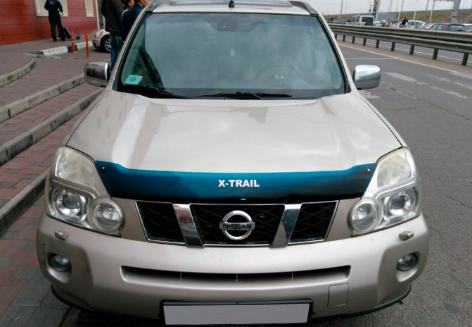Nissan X-Trail II спереди